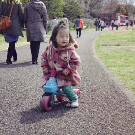 Little-big-boss riding on a bike!