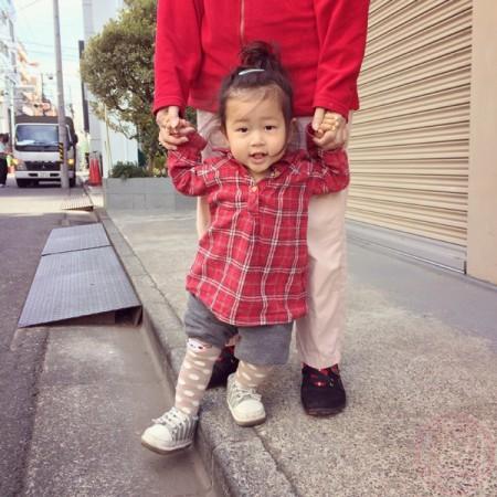 Yuto holding grandmama's hand for a walk
