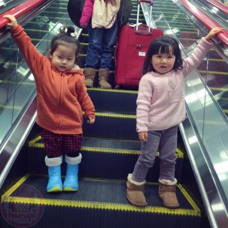 Little-big-boss and Yuki-chan at the escalator